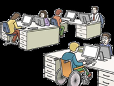 Mitarbeiter arbeiten im Büro an ihren Computern