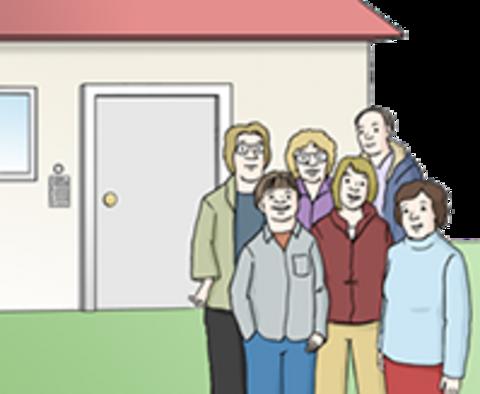 Bewohner einer Wohngruppe stehen vor ihrem Wohnhaus
