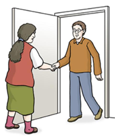 Ein Betreuer besucht eine Frau im Wohnheim